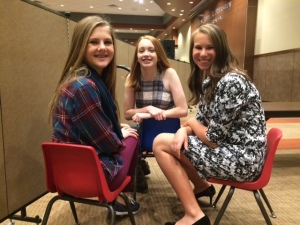 A few of the cutie-petutie models wait backstage before the show begins.